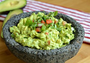 A Bowl of Guacamole in a Stone bowl